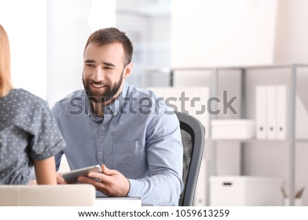 Businessman consulting young woman in office #1059613259