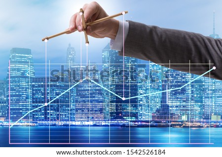 Businessman controlling the market with strings Foto stock ©