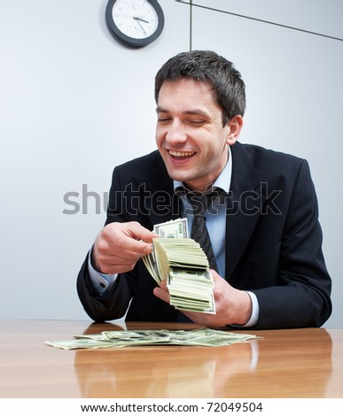 Businessman count pack of one hundred dollars in office