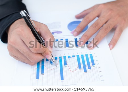 Businessman counting losses and profit