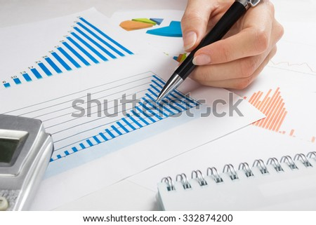 Businessman counting losses and profit working with statistics, analyzing financial the results. Copy space for your text. Business concept.