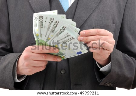 Businessman counting money. Financial background, euro banknotes.