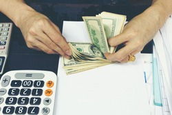 Businessman counting U.S. dollar bills
