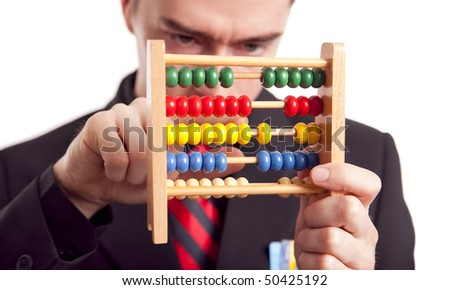 businessman counting with abacus