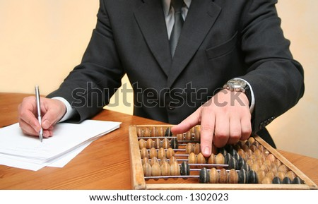 Businessman counting with an abacus