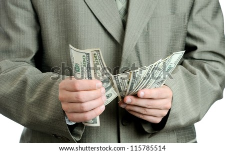 Businessman counts money. american dollars in the hands.