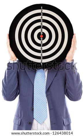 Businessman covering his face with a dartboard on white. Competition concept