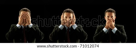 Businessman covering his mouth,eyes and hears on black background.