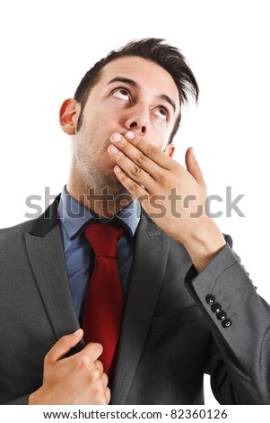 Businessman covering his mouth with his hand