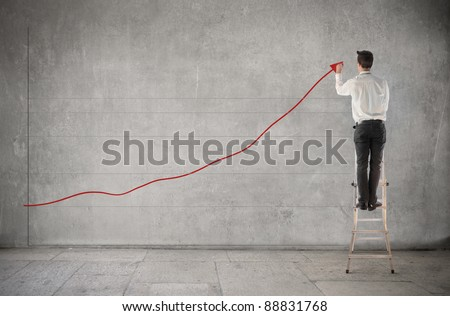 Businessman creating a chart of the earnings - stock photo