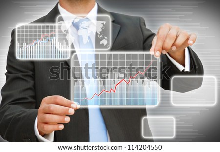 Businessman creating digital graphic