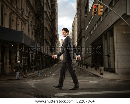 Businessman crossing a road