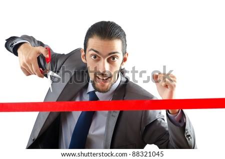 Businessman crossing finish line - stock photo