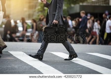 businessman crossing the street ...
