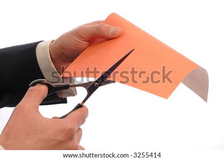 businessman cuts  color paper on  white background,  close up
