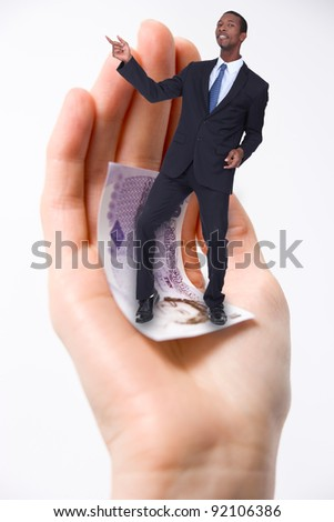 businessman dancing in a palm of a hand