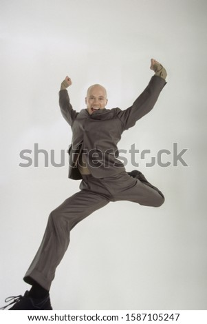 Businessman dancing, leaping in the air