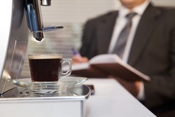 Businessman decided to use coffee without leaving the office