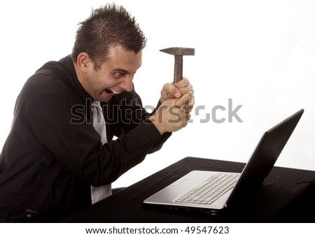 Businessman destroying his PC with a hammer