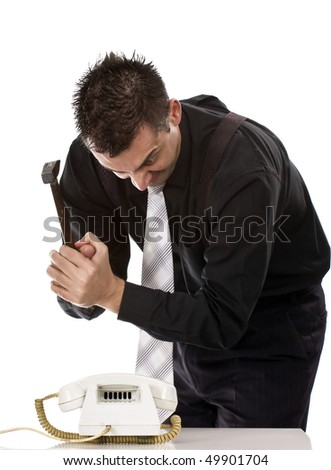 Businessman destroying his phone with a hammer - stock photo