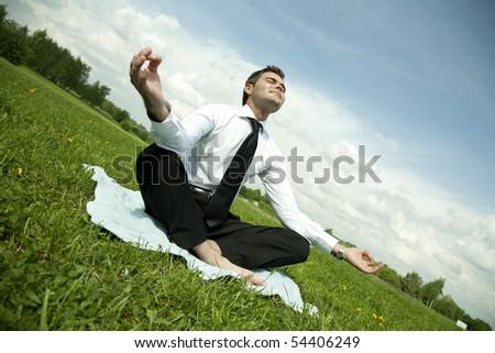 businessman do yoga exercise outdoor