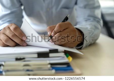 Businessman documents business report papers, job succes Analyze document plans #1226556574