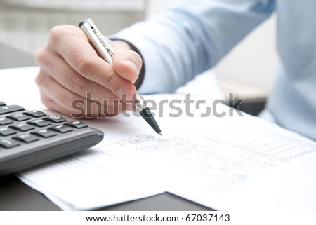 Businessman doing some paperwork in his office