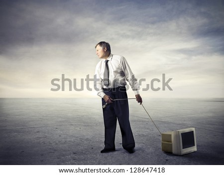 businessman drags television