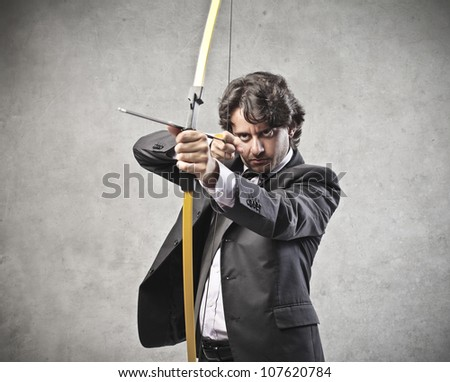 Businessman drawing a bow