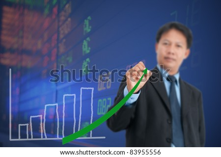 Businessman drawing a chart