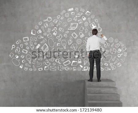 Businessman drawing a data cloud