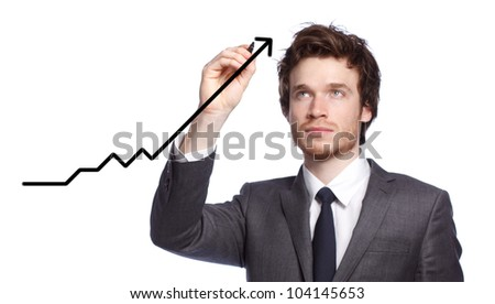 Businessman drawing a graph with black marker