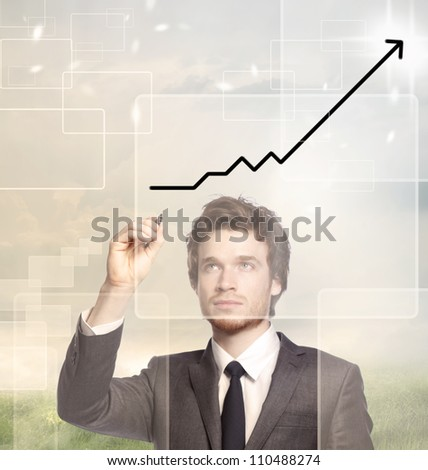 Businessman drawing a graph with black marker (growth)