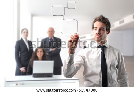 Businessman drawing a graphic with group of business people on the background