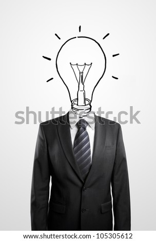 Businessman drawing a head lamp on a white background
