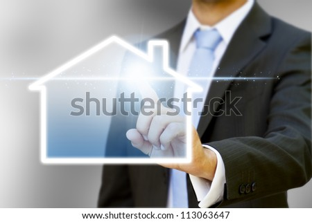 Businessman drawing a house with his finger