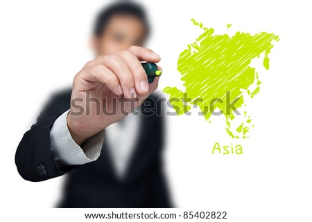 Businessman drawing a map of continent Asia.