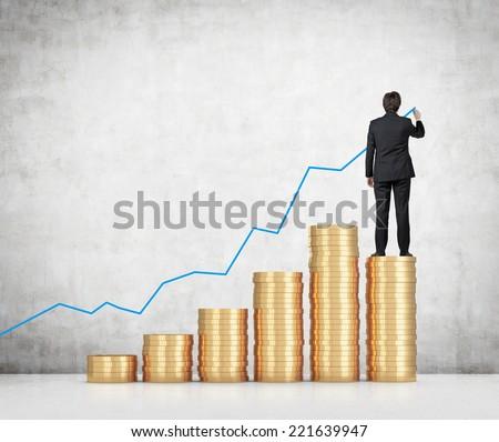 Businessman drawing a monetary line graph.