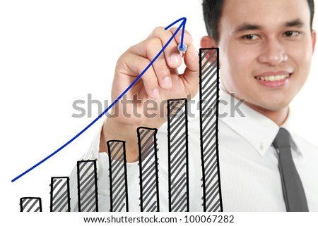 Businessman drawing a rising diagram, representing business growth.