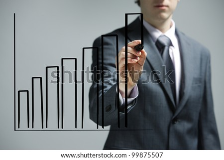 Businessman drawing a uptrend chart on screen