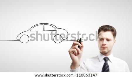 businessman drawing abstract car