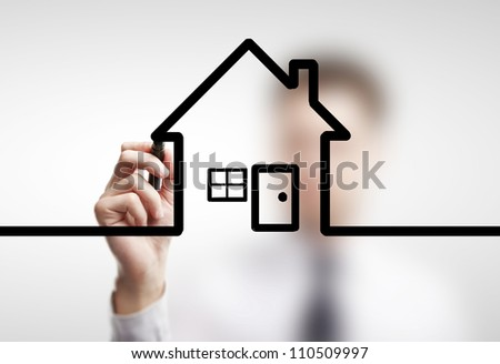 businessman drawing abstract  cottage on a white background - stock photo