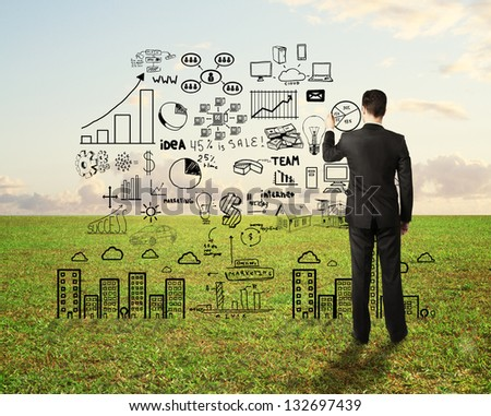 businessman drawing business strategy on field background