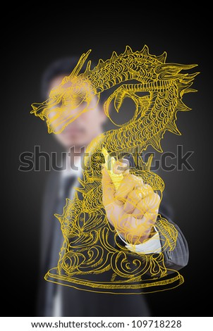 Businessman drawing Chinese Style dragon statue line.