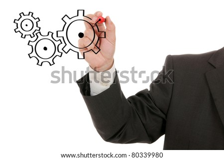 Businessman drawing cogwheels