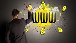 businessman drawing colorful light bulb with WWW abbreviation, new technology idea concept