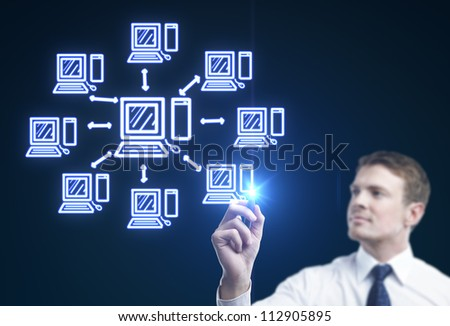 businessman drawing computer network on a blue background