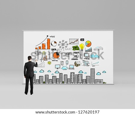 businessman drawing concept city on stand - stock photo