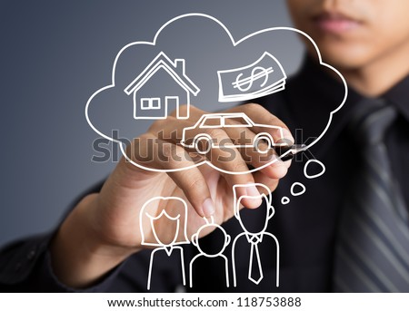 Businessman drawing dream house in a whiteboard
