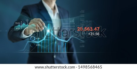 Businessman drawing graph growth and analyzing financial investment data, strategy and planing on blue background. #1498568465